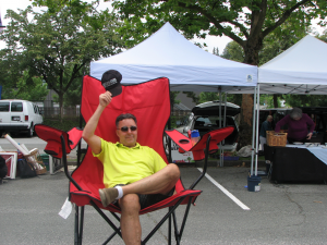 Bernie-on-Big-Red-Chair-at-Burnaby-Artisan-Farmer's-Market