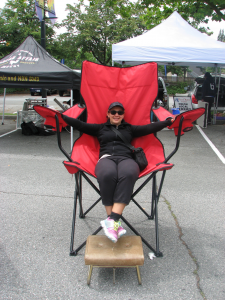 Carolina-on-the-Big-Red-Chair-at-Burnaby-Artisan-Farmer's-Market