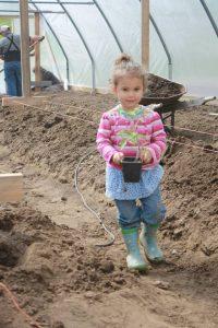 Child at Stein Mountain Farm in Lytton