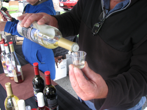 Pouring-Frobidden-Fruit-Wine-Sampler-at-Burnaby-Farmers-Market
