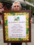 Janice with sign at farmers market